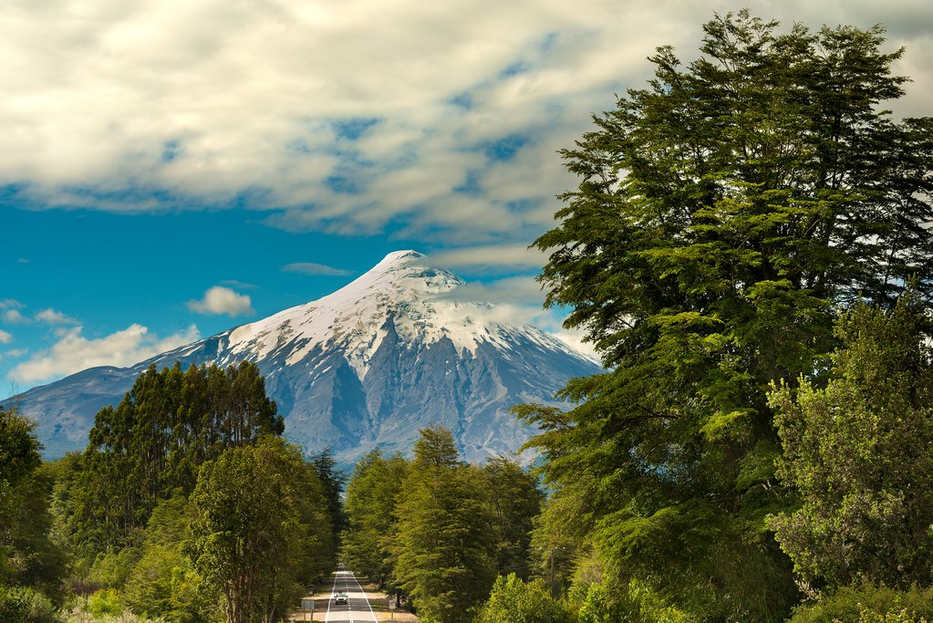 Hike a portion of the Osorno Volcano while staying in a German-style town
