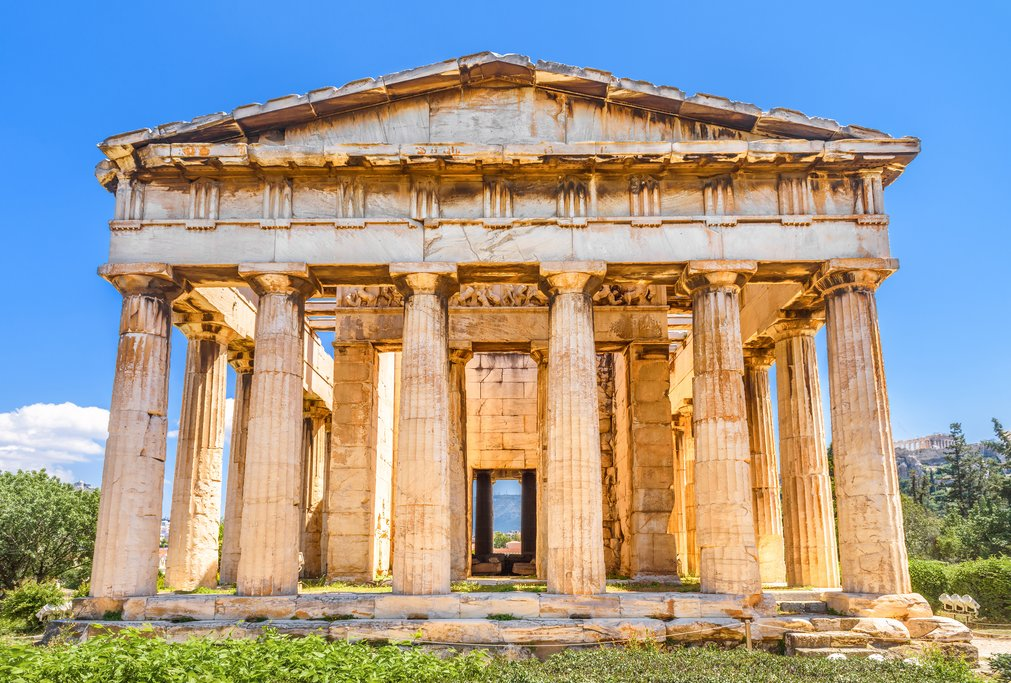 Temple of Hephaestus in the Ancient Agora, Athens, Greece. It is one of the main landmarks of Athens. Sunny view of the classical Greek temple in Athens center. Remains of antique Athens in sunlight.