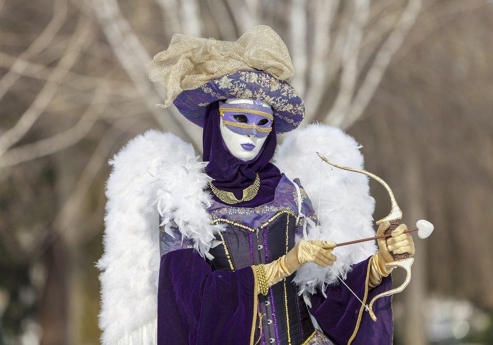 A masked Carnaval reveler