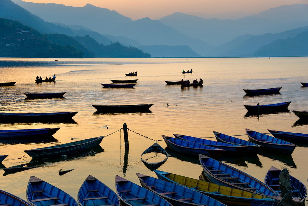 Boat rides at sunset on Phewa Lake