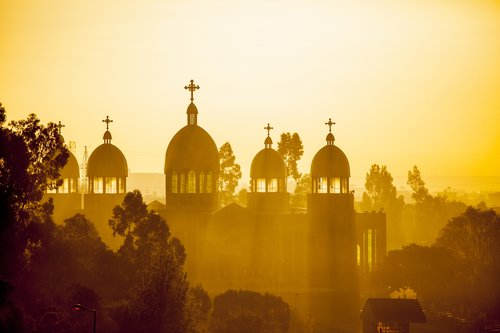 Ethiopian orthodox church with sun rays in Addis Ababa