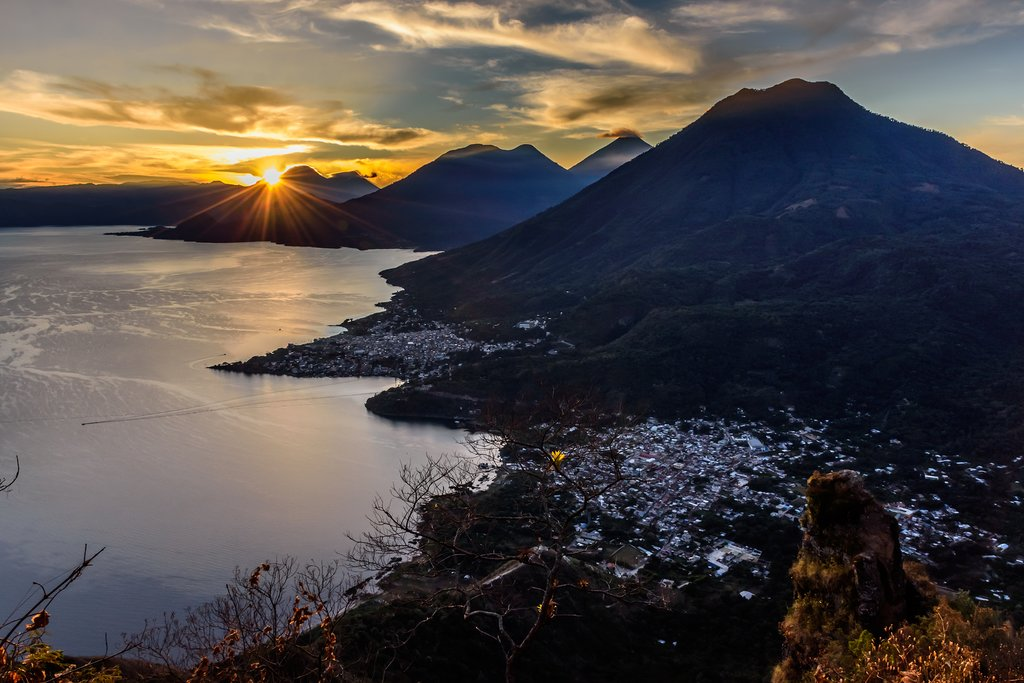 Take in a sunrise from Rupalaj K'istalin over Lake Atitlán, volcanoes, and Maya villages