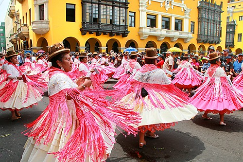 Women perform during the festival of the Virgin de la Candelaria in Lima