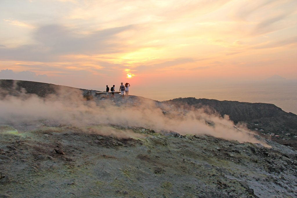 Trek the crater rim amid steaming fumaroles on Vulcano Island