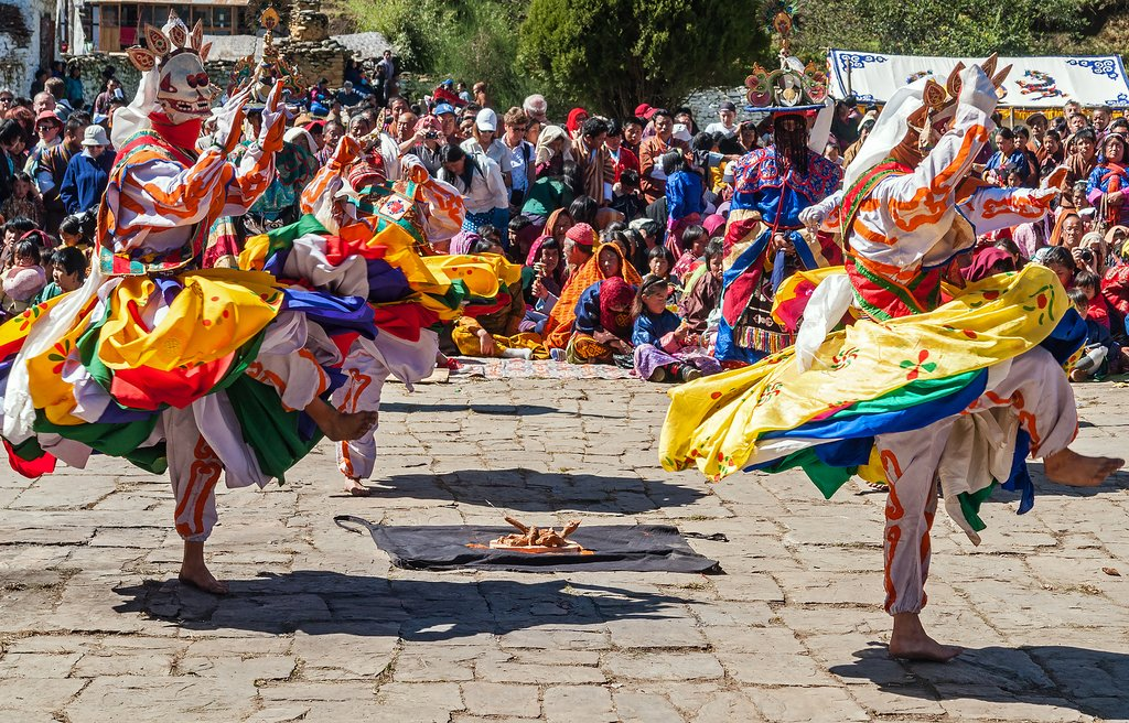 Traditional Bhutanese dancers in a street performance