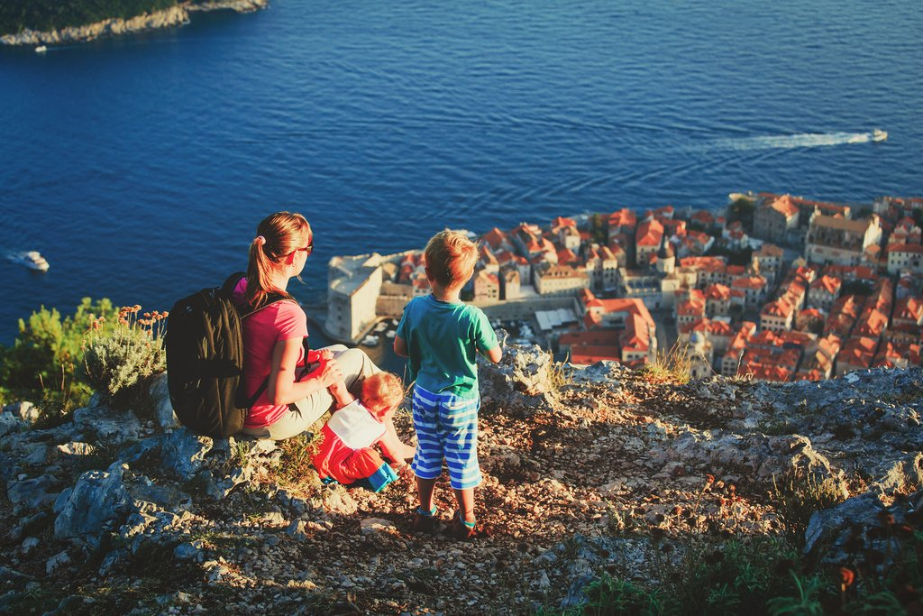 Mom and kids look over Dubrovnik's Old Town from Srđ Mountain
