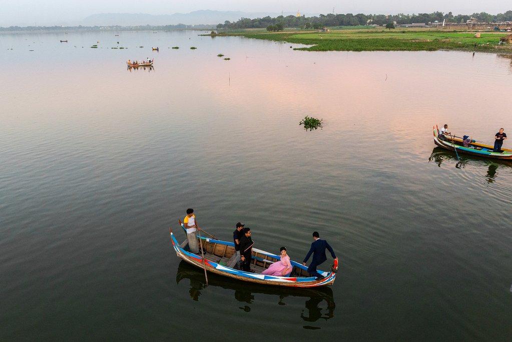 A boat below U Bein Bridge in Mandalay, Myanmar