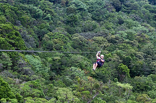 Riding a zip line high above the trees in Costa Rica