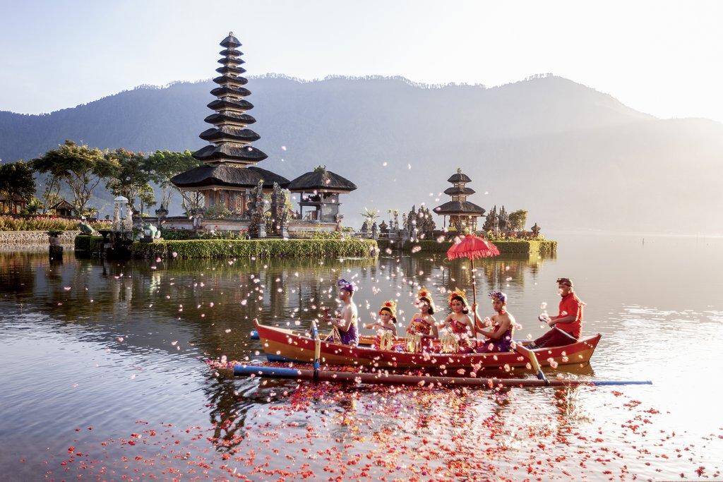 Beratan Lake in Bali Indonesia, June 6 2018 : Balinese villagers participating in traditional religious Hindu procession in Ulun Danu temple Beratan Lake in Bali Indonesia.