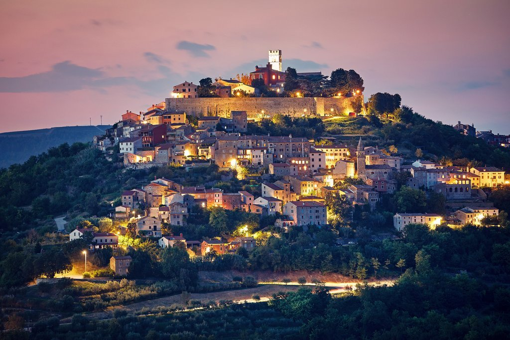 The medieval hilltop town of Motovun lights up at night