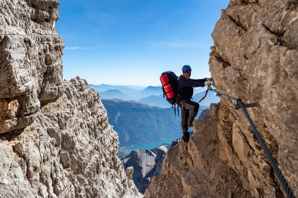 A mountain climber on a via ferrata (iron way) in the Dolomites in Italy