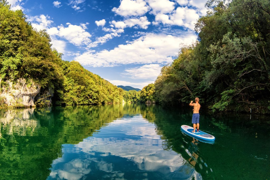 Stand up paddle board along a section of the breathtaking Soča River