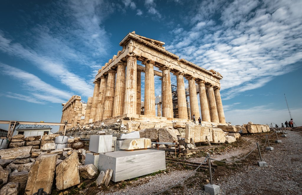 Parthenon on the Acropolis of Athens, Greece. Ancient Greek Parthenon is a top landmark of Athens. Panorama of ruins of the antique Athens city in summer. Famous old architecture in the Athens center.