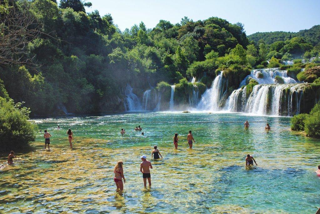 Splash in the emerald-green waters of Skradinski Buk falls in Krka National Park