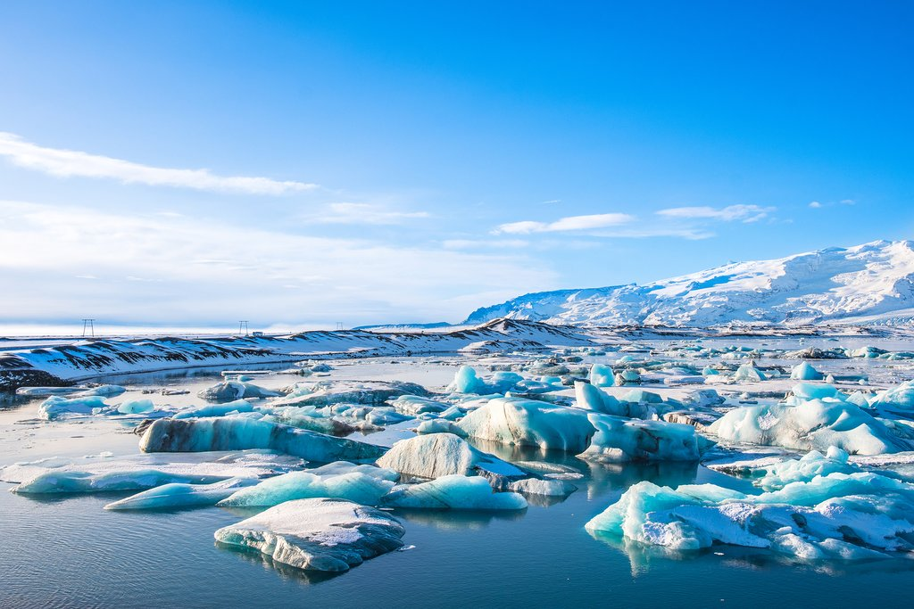 "Marvel at the ""diamonds"" of Jökulsárlón Lagoon and the distant Vatnajökull"