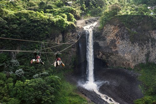 Ziplining towards a waterfall near the town of Baños