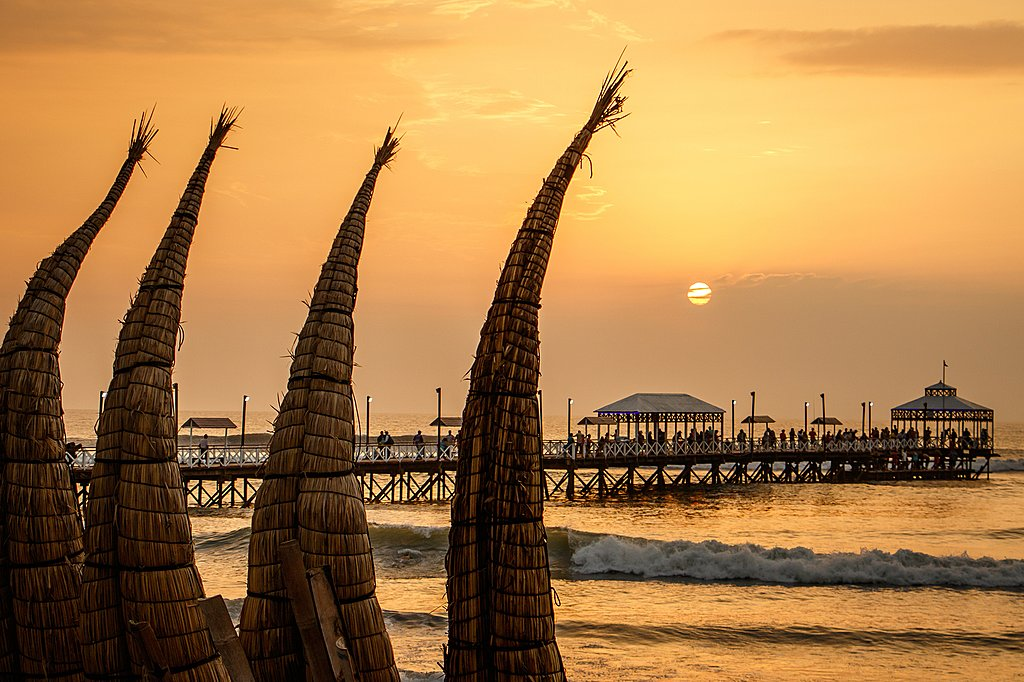 Sunset in Huanchaco with traditional totora reed boats