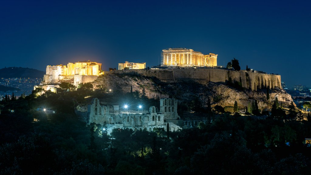 Acropolis of Athens at night, Greece. It is a top landmark of Athens. Scenic panorama of illuminated Ancient Greek ruins with Parthenon temple in evening. Landscape of Athens city at dusk.