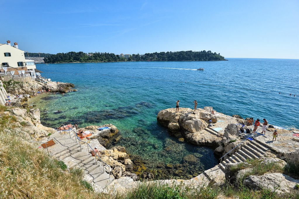 Cool off with the family at a beach near Rovinj's town center