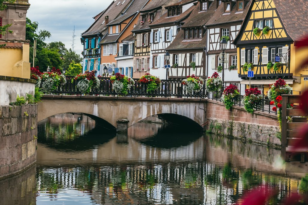 Flower lined bridge along the canals of Colmar