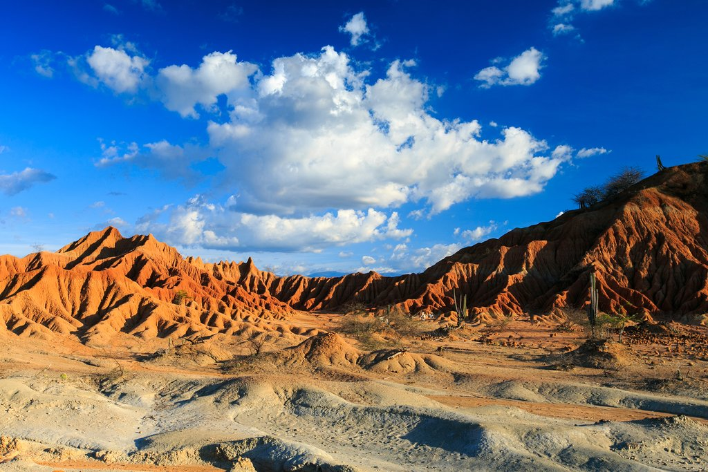 Discover the red sand and rock formations of the Tatacoa Desert