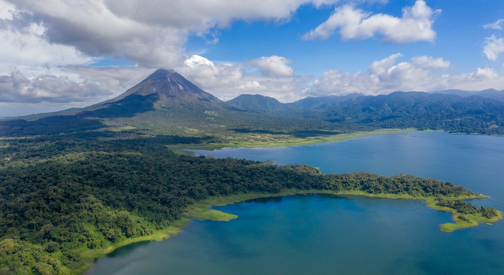 Arenal, one of Costa Rica's most majestic landmarks, towers over the countryside