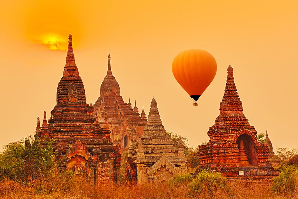 Balloons over Htilominlo Temple at sunrise, Bagan
