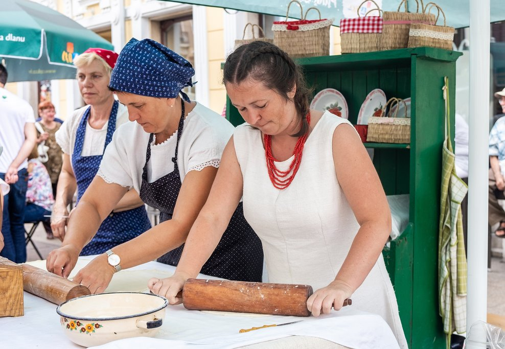Women rolling dough at a traditional food stand in Rijeka, Croatia