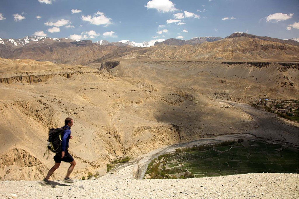 Running on wide, ancient trails between the fertile patches of village fields in Upper Mustang