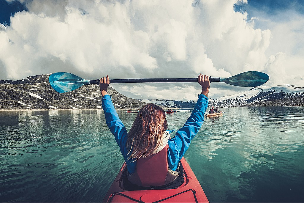 Woman kayaking near Jostedalsbreen glacier