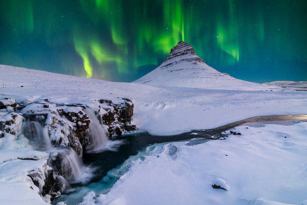 The Northern Lights above snowy Kirkjufellsfoss