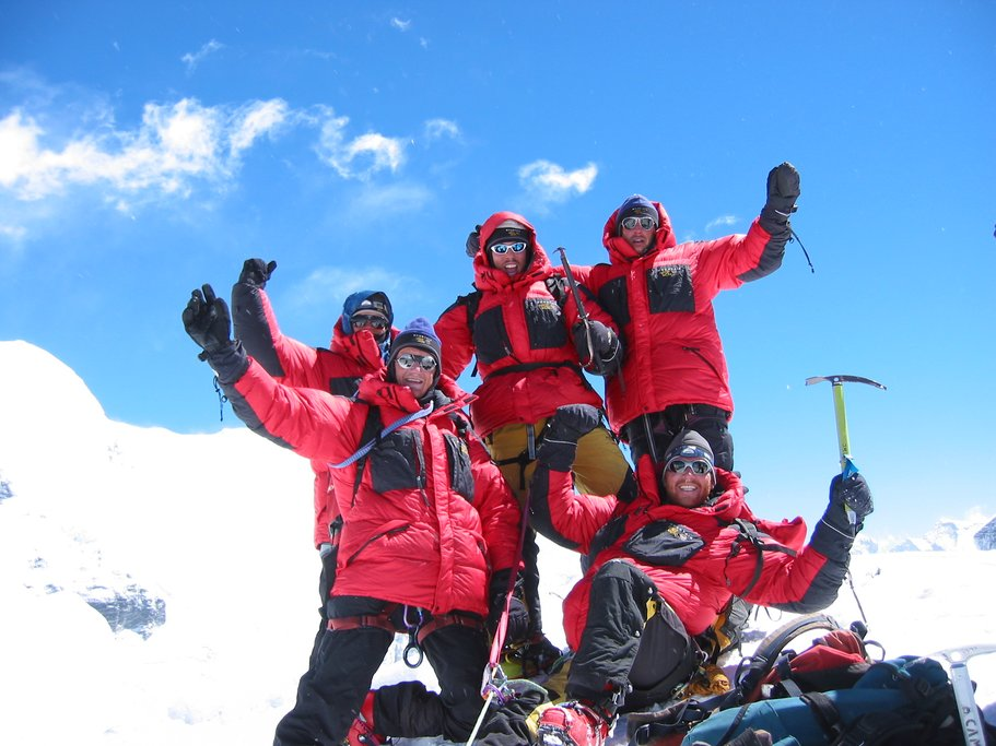 A team of climbers on the summit of Island Peak