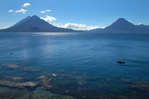 Lake Atitlan with volcanoes in the background