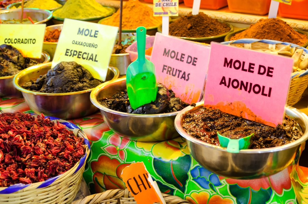Different types of mole and spices in a marketplace in Oaxaca, Mexico