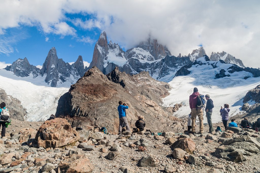A group of hikers at the base of Mt. Fitz Roy