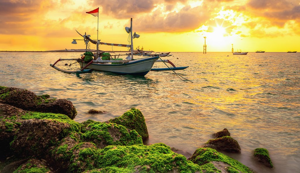Traditional fishing boats at Sanur beach, Bali, Indonesia