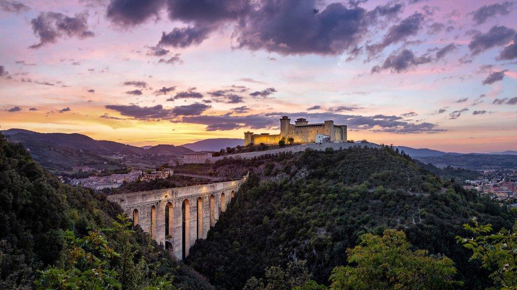 Spoleto at sunset, with the medieval bridge of Ponte delle Torri and Rocca Albornoziana hilltop fortress