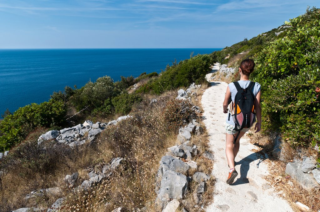 Pick up a rugged, but beautiful, coastal trail through Mljet National Park
