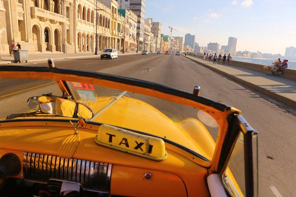 Convertible classic car taxi on Malecon, Havana, Cuba; copyright Christopher P Baker. All rights reserved.