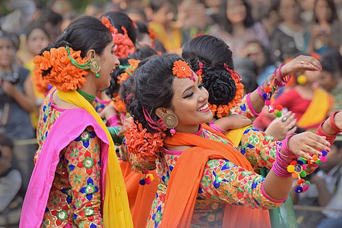 Colorfully dressed dancers performing at a street fair in Kolkata