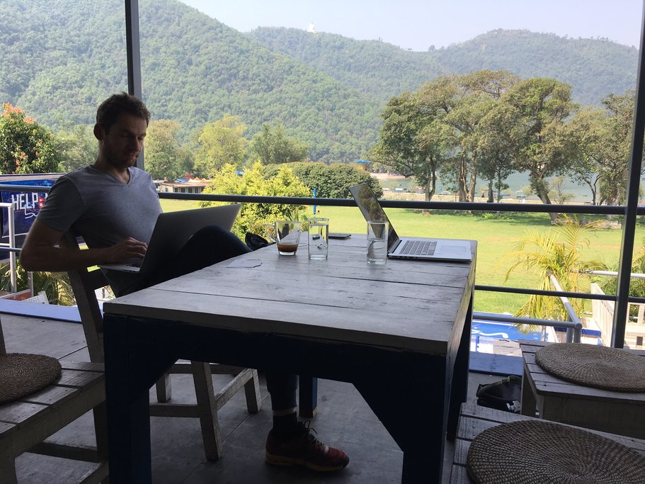 kimkim engineering team shipping new product in Pokhara with Phewa lake in the background