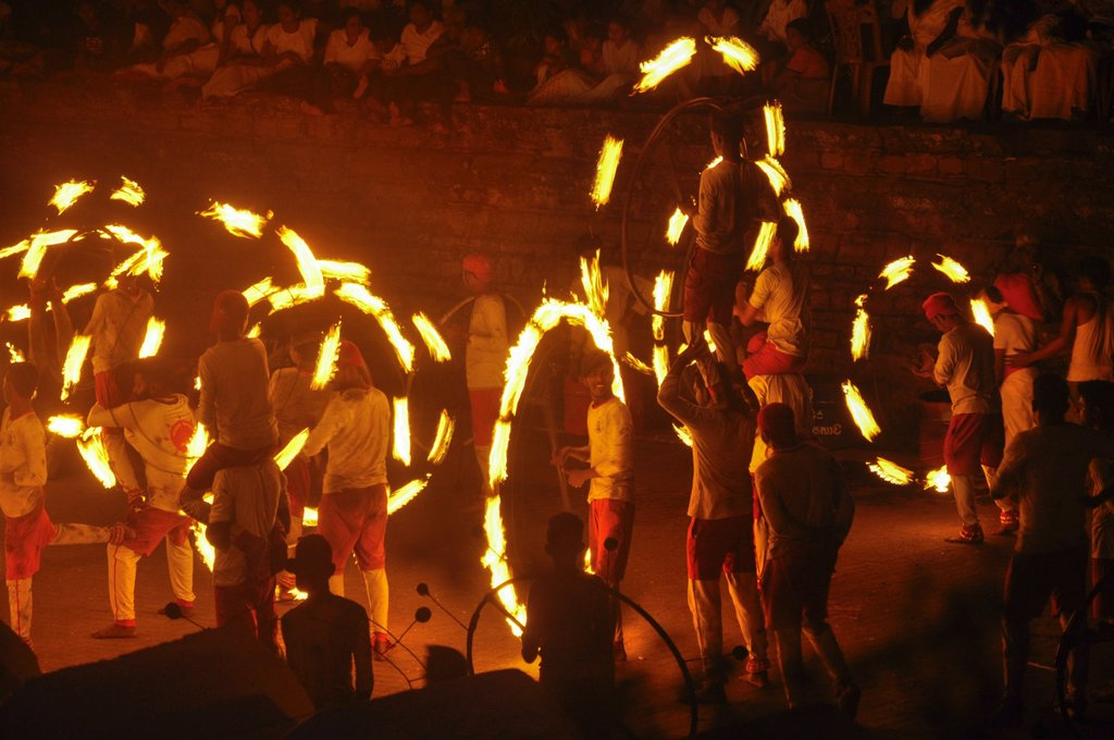 Fire dancers perform at the Kandy Perahera (Photo courtesy of Pexels)