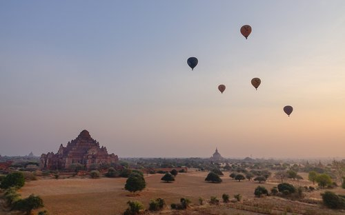 Hot air balloons flying over Dhammayangyi Temple in Bagan