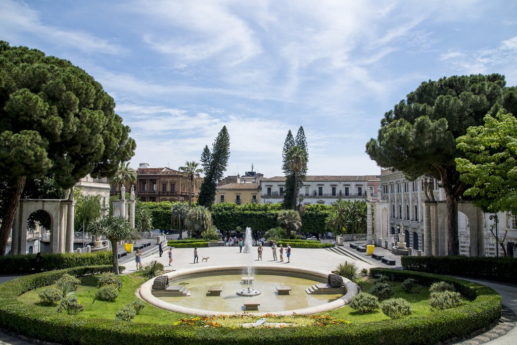 Stroll through the manicured gardens of Catania's Villa Bellini park