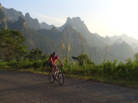 Riding through the stunning topography of northern Laos