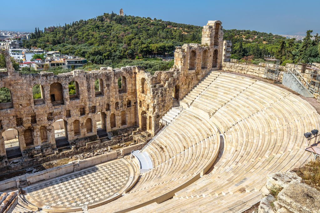 Odeon of Herodes Atticus at Acropolis, Athens, Greece. It is one of the main landmarks of Athens. Antique amphitheater close-up. Scenic view of famous Ancient Greek ruins in the Athens center.