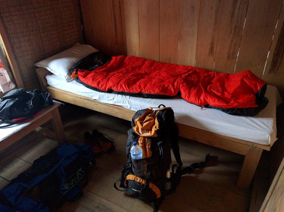 Sleeping bag and backpack in Khopra Danda lodge room
