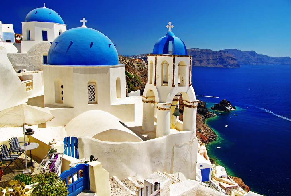 White and blue churches over Santorini's caldera