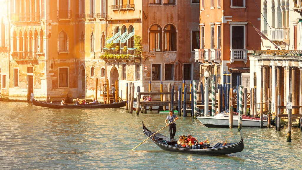 A gondolier steers a boat in Venice