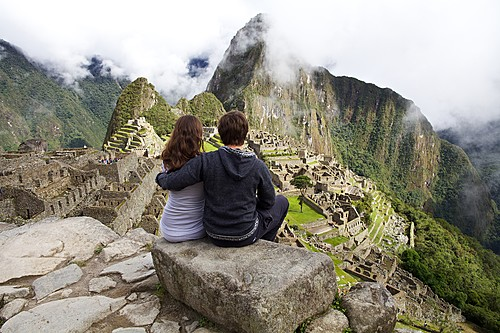 Couple enjoying the views of Machu Picchu citadel